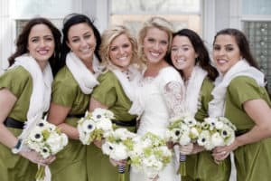 green and white winter wedding flowers – photo by Chudleigh Weddings
